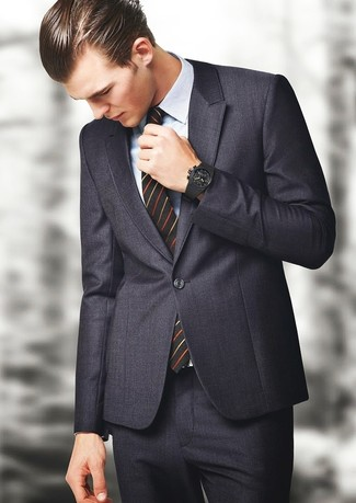 How to wear: black rubber watch, black vertical striped tie, light blue plaid dress shirt, charcoal suit