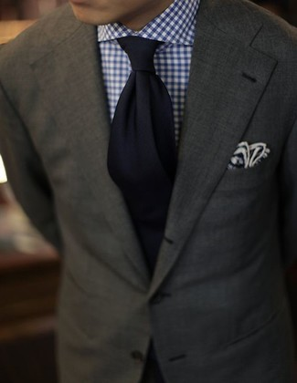 How to wear: navy pocket square, black tie, white and navy gingham dress shirt, olive blazer