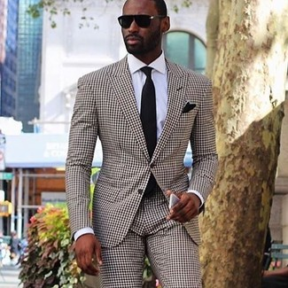 How to Wear a Brown Check Suit: A brown check suit and a white dress shirt are absolute essentials if you're figuring out a sharp closet that matches up to the highest sartorial standards.