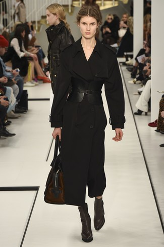 How to wear: black trenchcoat, dark brown leather ankle boots, dark brown leather duffle bag, black leather waist belt