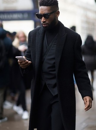How to wear: black wool dress pants, black turtleneck, black waistcoat, black overcoat