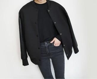 How to wear: black varsity jacket, black long sleeve t-shirt, black skinny jeans