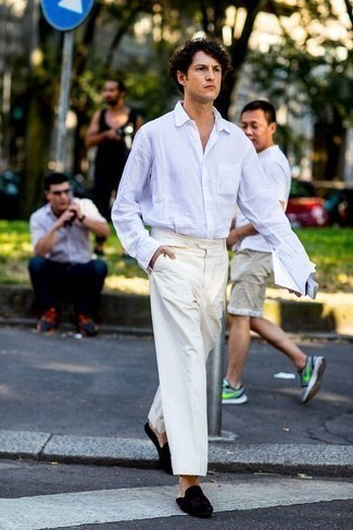Men's Looks & Outfits: What To Wear In 2020: A white long sleeve shirt and white chinos will allow you to flaunt your sartorial side. Puzzled as to how to complete this look? Wear a pair of black velvet loafers to lift it up.