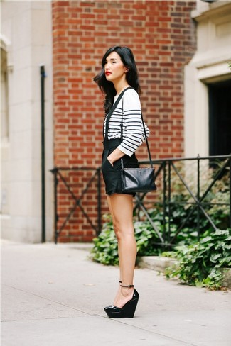 How to wear: black leather crossbody bag, black leather wedge pumps, black shorts, white and navy horizontal striped long sleeve t-shirt