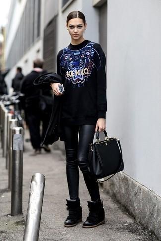 How to wear: black leather handbag, black leather wedge sneakers, black leather leggings, black print oversized sweater