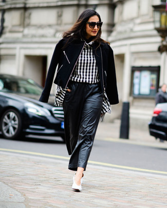 How to Wear Black Leather Wide Leg Pants: This pairing of a black wool biker jacket and black leather wide leg pants is a safe go-to for an effortlessly stylish look. To bring an extra dimension to this outfit, complement your outfit with a pair of white leather pumps.