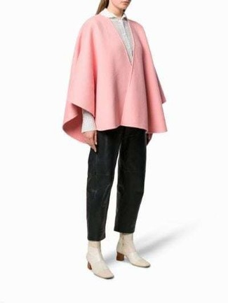 How to Wear a Pink Cape Coat: A pink cape coat and black leather wide leg pants are the kind of a fail-safe combination that you so desperately need when you have no time. As for shoes, throw in a pair of beige leather ankle boots.