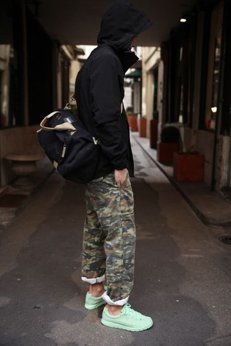 How to wear: black windbreaker, olive camouflage chinos, mint athletic shoes, black canvas duffle bag
