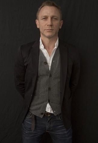 Daniel Craig wearing Black Blazer, Grey Cardigan, White Long Sleeve Shirt, Navy Jeans