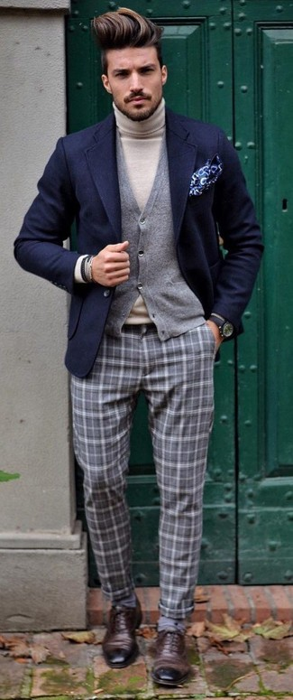 Something as simple as opting for a navy wool blazer and grey plaid dress pants can potentially set you apart from the crowd. You could perhaps get a little creative when it comes to footwear and elevate your outfit with dark brown leather oxford shoes. We love how perfect this one is for awkward transition weather.