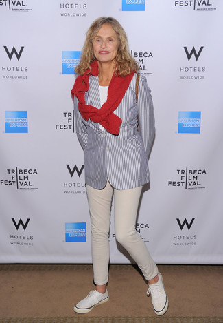 Lauren Hutton wearing Grey Vertical Striped Blazer, Red Crew-neck Sweater, White Crew-neck T-shirt, Beige Jeans