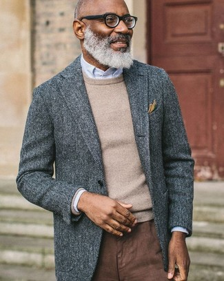 How to wear: grey herringbone wool blazer, beige crew-neck sweater, light blue vertical striped dress shirt, brown chinos