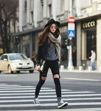 A black blazer and grey sunglasses are perfect for both running errands and a night out. Choose a pair of grey low top sneakers for a more relaxed feel. This one is a solid pick when it comes to a comfortable transition look.