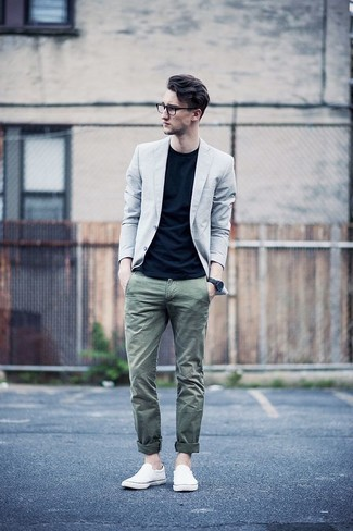 How to wear: grey blazer, black crew-neck t-shirt, olive chinos, white canvas slip-on sneakers