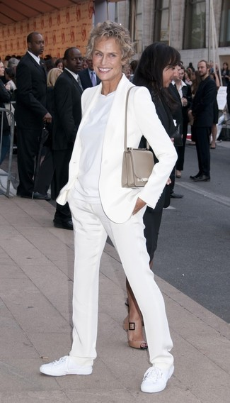 Lauren Hutton wearing White Blazer, White Crew-neck T-shirt, White Dress Pants, White Canvas Low Top Sneakers