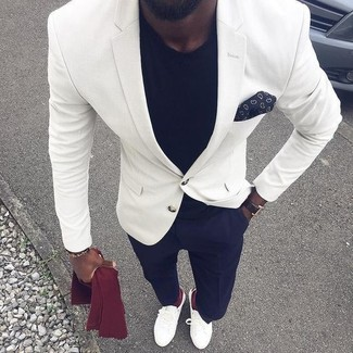 How to wear: white blazer, black crew-neck t-shirt, navy dress pants, white leather loafers