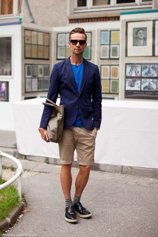 How to wear: navy blazer, blue crew-neck t-shirt, tan shorts, black leather derby shoes