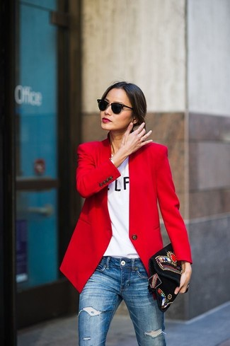 How to wear: red blazer, white and black print crew-neck t-shirt, blue ripped skinny jeans, black embroidered suede clutch