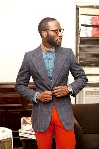 How to wear: charcoal check blazer, blue denim shirt, orange chinos, blue print bow-tie