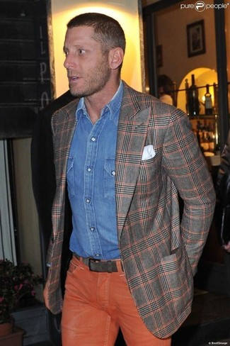How to wear: grey plaid blazer, blue denim shirt, orange jeans, white pocket square