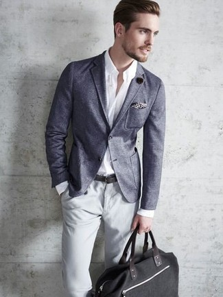 How to wear: charcoal blazer, white dress shirt, grey chinos, black canvas duffle bag