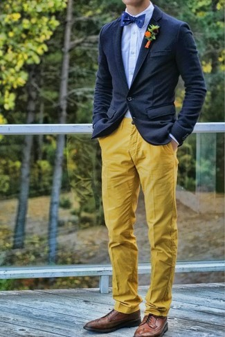 How to wear: navy wool blazer, light blue dress shirt, yellow chinos, brown leather brogues