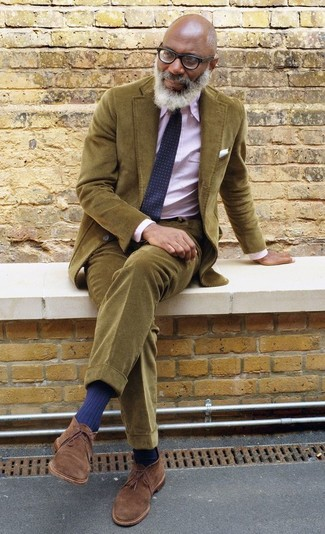 How to wear: olive corduroy blazer, pink vertical striped dress shirt, olive corduroy chinos, brown suede desert boots