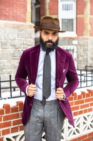 Let everyone know that you know a thing or two about style in a velvet suit jacket and grey plaid wool dress pants.