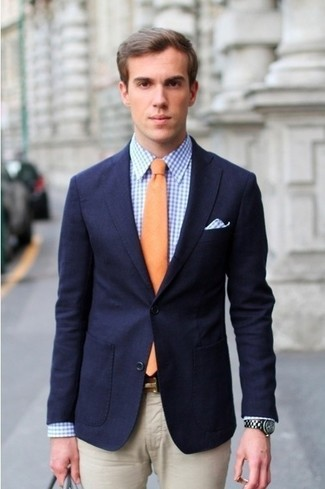 Pair a navy sport coat with beige suit pants for a sharp, fashionable look. It is indeed possible to look fresh and clean under the crazy heat. The proof is right here.