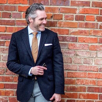 How to wear: navy vertical striped blazer, light blue dress shirt, grey dress pants, orange print tie