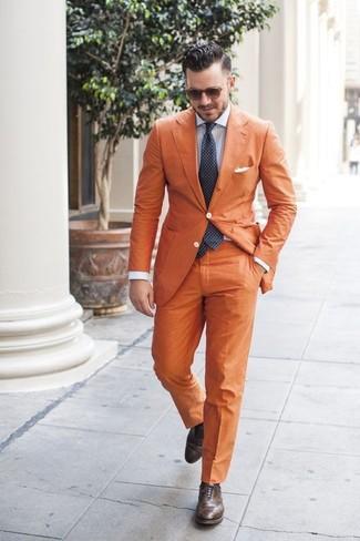 How to wear: orange blazer, light blue vertical striped dress shirt, orange dress pants, dark brown leather brogues