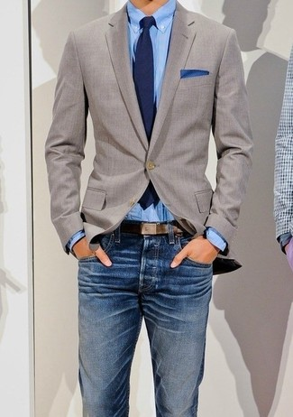 Effortlessly blurring the line between elegant and casual, this combination of a blazer jacket and blue jeans is likely to become one of your favorites.