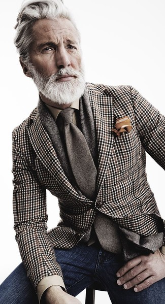 No matter where you go over the course of the day, you'll be stylishly prepared in a brown houndstooth suit jacket and navy jeans.