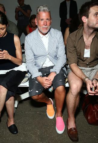 Nick Wooster wearing Light Blue Vertical Striped Blazer, White Dress Shirt, Charcoal Print Shorts, Orange Slip-on Sneakers
