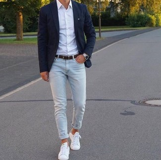 How to wear: black blazer, white dress shirt, light blue skinny jeans, white leather low top sneakers