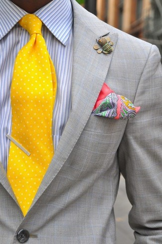 How to wear: grey blazer, grey vertical striped dress shirt, yellow polka dot tie, pink paisley silk pocket square