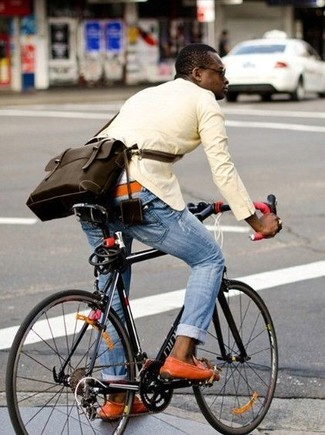 How to wear: yellow blazer, light blue ripped jeans, orange suede boat shoes, dark brown leather messenger bag
