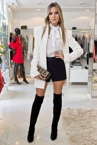 How to wear: white blazer, white long sleeve blouse, black shorts, black suede over the knee boots