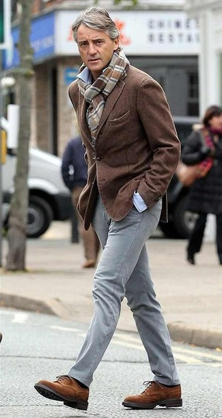 Roberto Mancini wearing Brown Wool Blazer, Light Blue Long Sleeve Shirt, Grey Chinos, Brown Suede Brogues