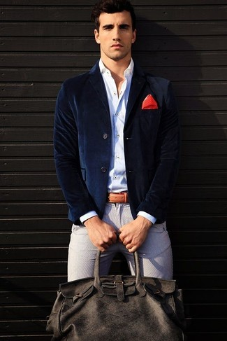 How to wear: navy velvet blazer, white long sleeve shirt, grey chinos, charcoal leather holdall