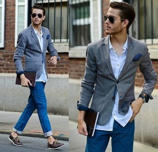 How to wear: grey blazer, light blue long sleeve shirt, blue jeans, dark brown leather boat shoes