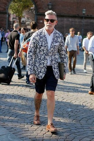 Nick Wooster wearing Navy and White Floral Blazer, White Long Sleeve Shirt, Navy Shorts, Brown Leather Derby Shoes