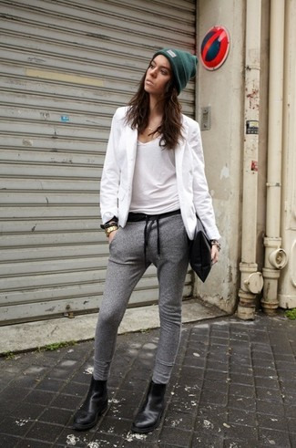 A white blazer and grey track pants will convey a carefree, cool-girl vibe. For the maximum chicness throw in a pair of black leather chelsea boots.