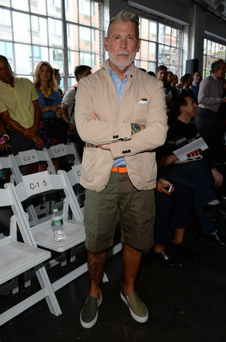 Nick Wooster wearing Beige Cotton Blazer, Light Blue Short Sleeve Shirt, Olive Shorts, Olive Leather Slip-on Sneakers