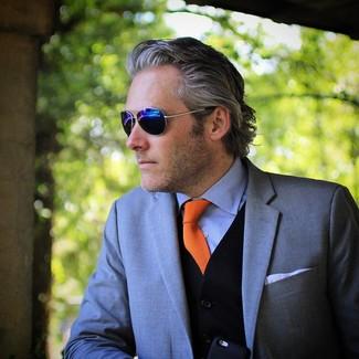 How to wear: grey blazer, black sweater vest, light blue dress shirt, orange tie