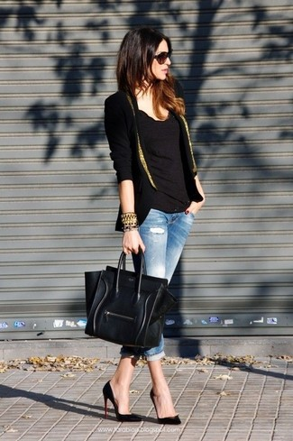 Try pairing a black and gold blazer with light blue distressed skinny jeans to bring out the stylish in you. Polish off the ensemble with black leather pumps.