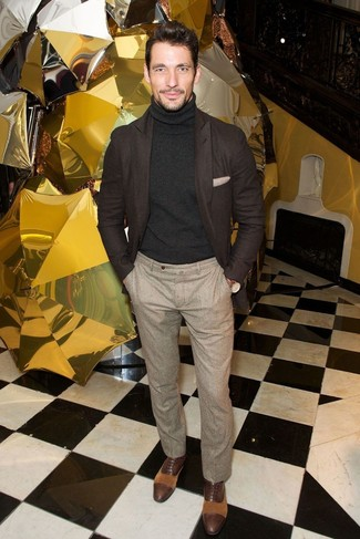 David Gandy wearing Dark Brown Wool Blazer, Black Turtleneck, Beige Wool Dress Pants, Dark Brown Leather Oxford Shoes