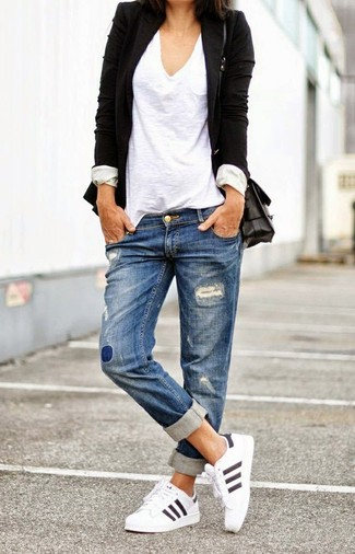 A black blazer jacket and blue distressed boyfriend jeans will convey a carefree, cool-girl vibe. A good pair of white running shoes are sure to leave the kind of impression you want to give. Rest assured, this look is the answer to all of your transitional style woes.