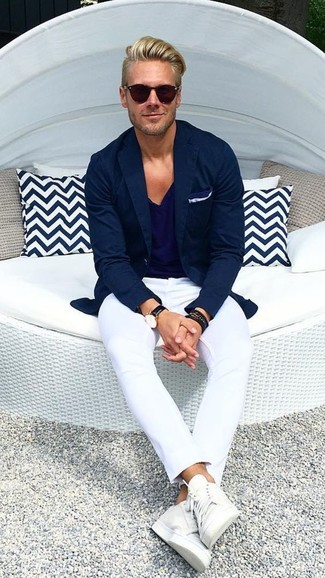 How to wear: navy blazer, navy v-neck t-shirt, white chinos, white leather low top sneakers