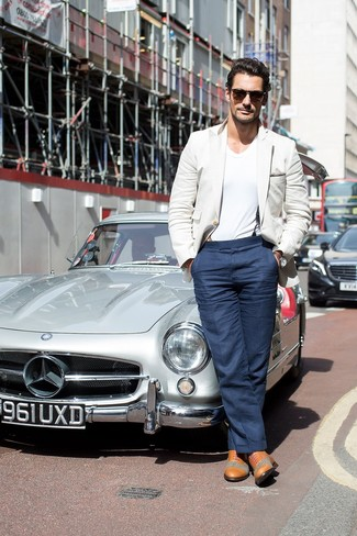 David Gandy wearing Beige Blazer, White V-neck T-shirt, Navy Dress Pants, Tan Leather Oxford Shoes